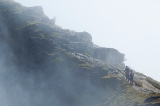 Climbers in the mist below